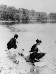 Ellen and assistant testing water at Jamaica pond.tif